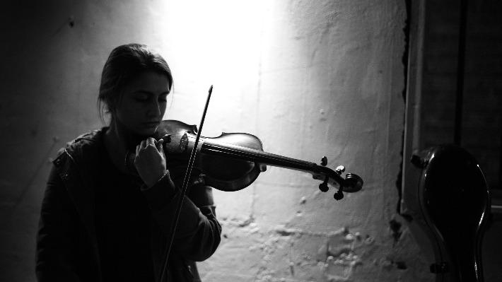Violinist tuning instrument
