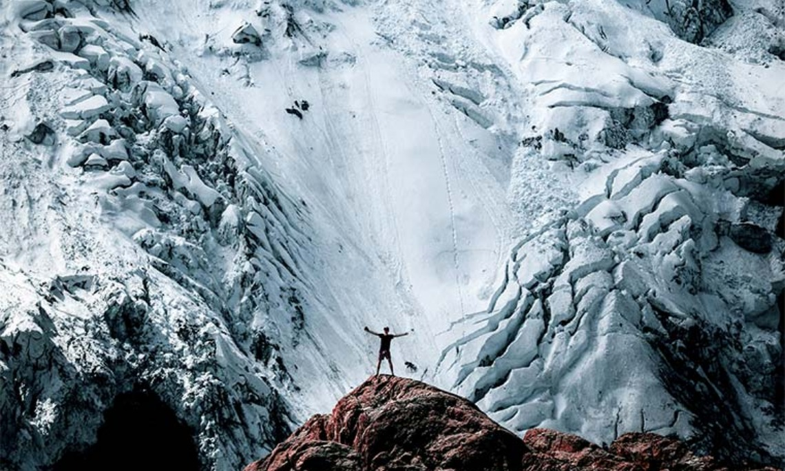 Man on rock overlooking avalanche: To them God has chosen to make knownamong the Gentiles the glorious riches of this mystery, which is Christ in you,the hope of glory (Colossians 1:27).